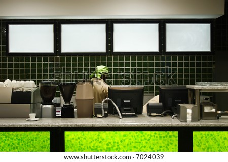 African American working in a coffee shop. - stock photo