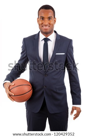 African American young business man holding a basketball, isolated on white