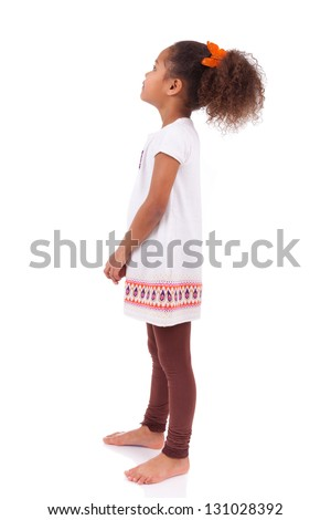 African Asian girl looking to something, isolated on white background - stock photo