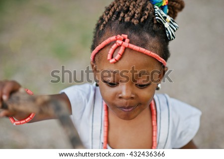 African baby girl walking at park - stock photo
