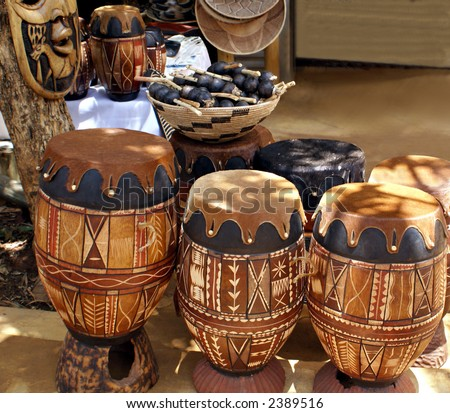 African bongo drums outside a market stall