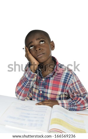 African Boy having stress while learning, Studio Shot - stock photo