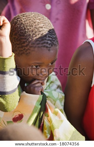 african boy living in a very poor community in a village near Kalahari desert - stock photo