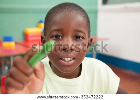 African boy playing with a pencil