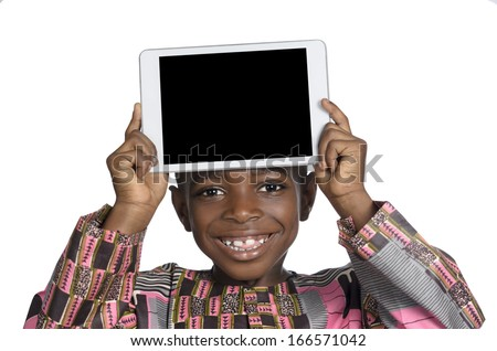 African Boy showing Tablet PC, Free Copy Space, Studio Shot - stock photo