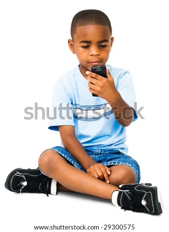 African boy text messaging on a mobile phone isolated over white - stock photo