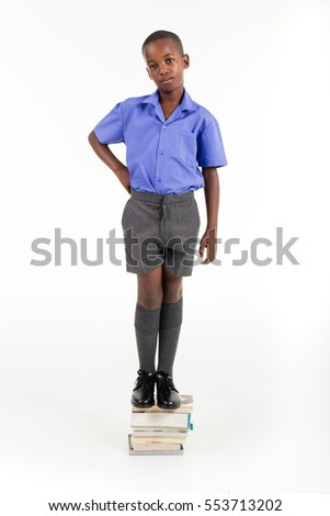 African boy wearing his school uniform ready to go back to school.