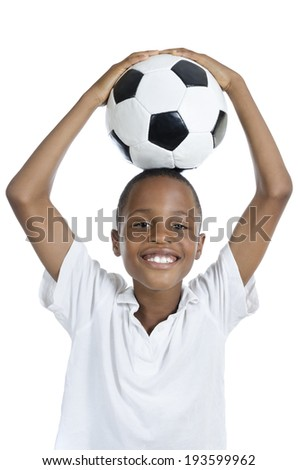 African Boy with Football smiling, Studio Shot, Isolated - stock photo