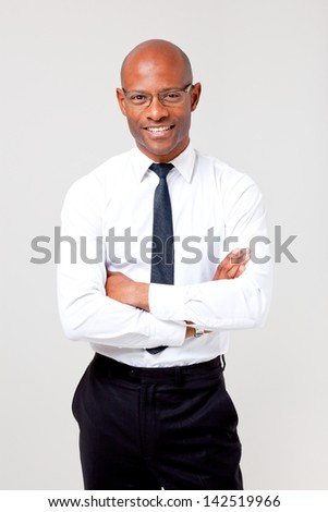 African business man folding his arms shot on an isolated background - stock photo