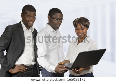 African Business People discussing with notebook, Studio Shot