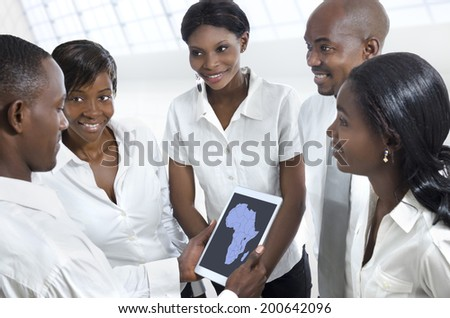 African business team discussing with tablet PC, Studio Shot - stock photo