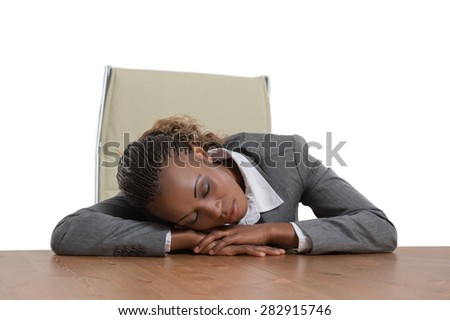 African business woman sitting at her desk and sleeping isolated on white background - stock photo