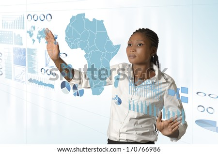 African business woman working on virtual touchscreen, Studio Shot - stock photo