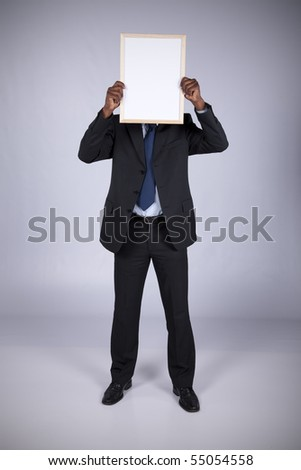 african businessman holding a blank whiteboard - stock photo