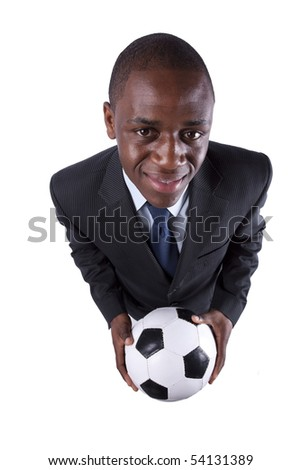 African businessman holding a soccer ball (isolated on white) - stock photo