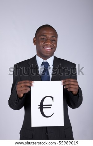 african businessman holding the european currency symbol (euro) - stock photo
