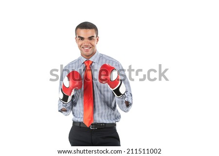African businessman in boxing gloves over white background. Business man wearing boxing gloves and smiling
