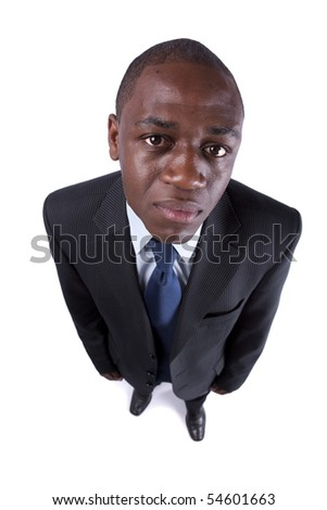 African businessman looking up with a silly expression (isolated on white) - stock photo