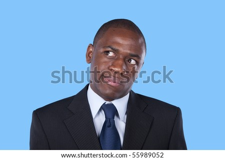 African businessman looking up with a suspicion expression - stock photo