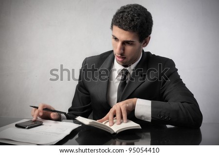 African businessman making a financial plan - stock photo