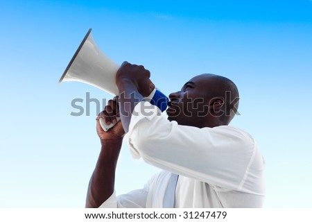 African businessman shouting in a megaphone - stock photo