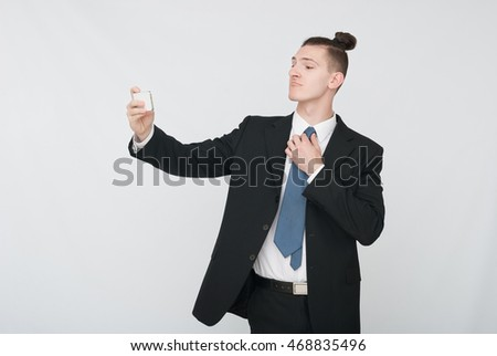 African Businessman Talking On Telephone Over White Background