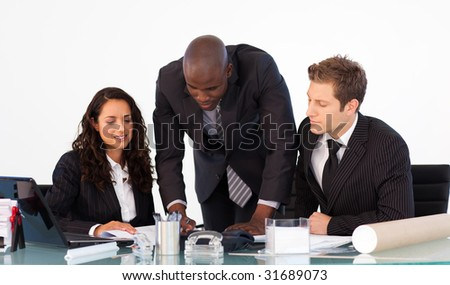 African businessman talking to his team in a meeting