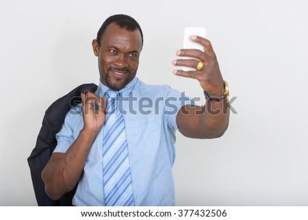 African businessman using phone - stock photo