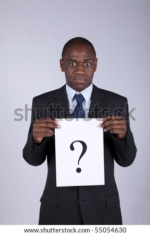 African businessman with a big question - stock photo