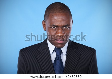 african businessman with a evil and powerful look - stock photo