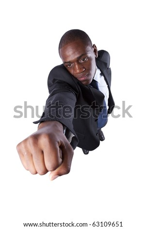 African businessman with his fist up (isolated on white) - stock photo