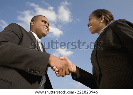 African businesspeople shaking hands - stock photo