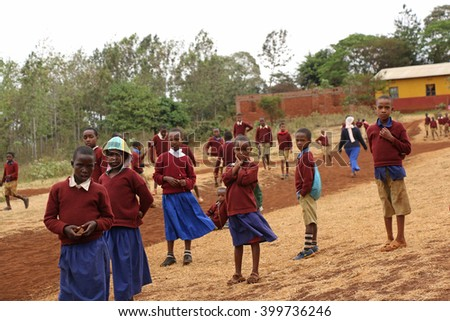 African Children at School / Kids playing outdoors in a primary school near Karatu, Tanzania / Photo taken at Kambi ya Nyoka Primary School, Karatu, Tanzania on October 9, 2015. - stock photo