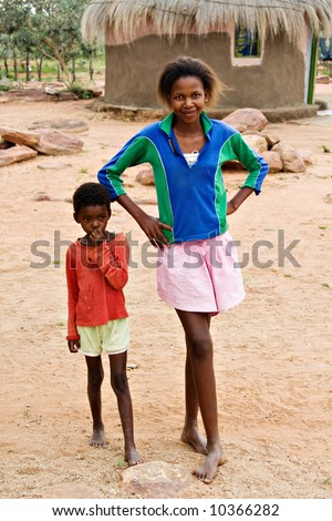 African children brother and sister, social issues, poverty, village near Kalahari desert - stock photo