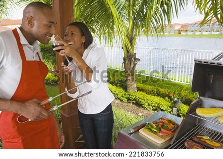 African couple barbecuing - stock photo