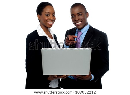 African coworkers operating laptop and pointing. Al on white background
