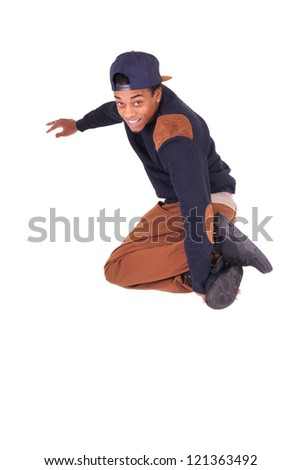 African dancer breakdance jumping isolated over white background - stock photo