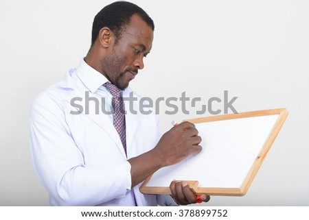 African doctor holding white board