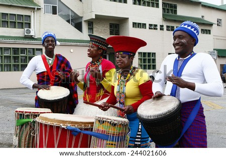 African drummers and musicians standing and playing outside a sports stadium on the 26 Dec 2014 - stock photo