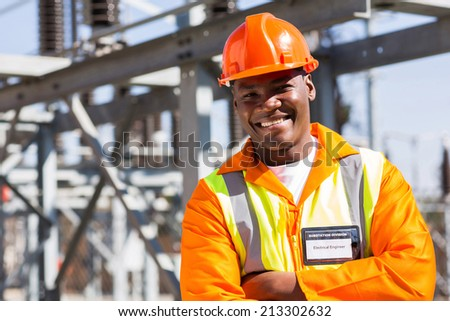 african electrical worker in electric substation - stock photo