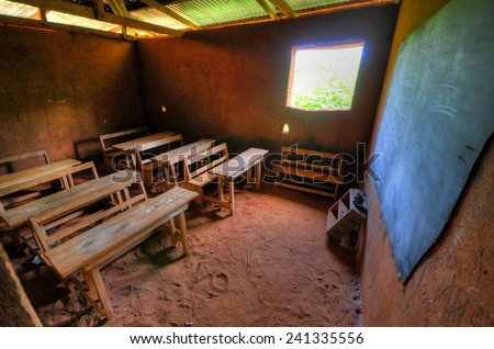 African Elementary School Classroom in a clay building with dirt floors. - stock photo