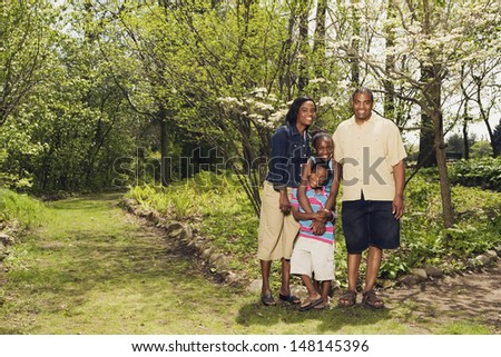 African family hugging in park