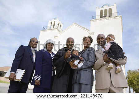 African family in front of church - stock photo
