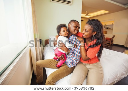 african family with child at home - stock photo