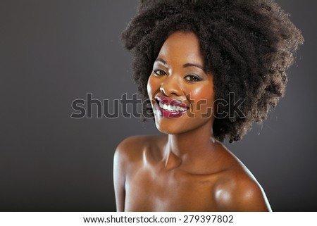 african female beauty on black background - stock photo