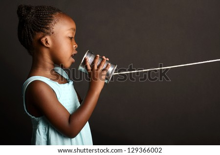 African girl communicating through a tin