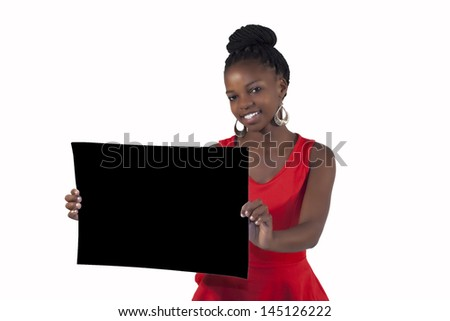 African girl holding a blank sign against a white background - stock photo
