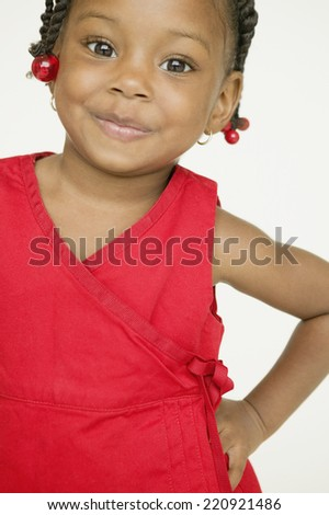African girl with hand on hip - stock photo