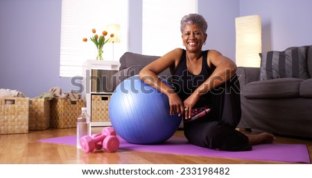 African grandmother happy after working out - stock photo