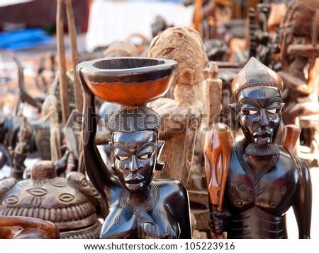 african handcraft dark wood carved people figures - stock photo